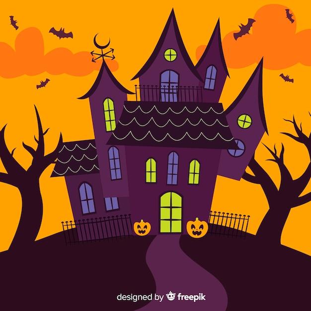 Cartoon halloween huis in plat ontwerp Gratis Vector