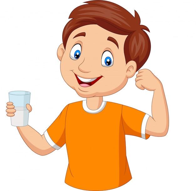 Cartoon jongetje met een glas melk Premium Vector
