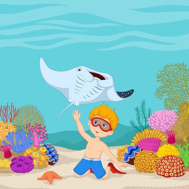 Cartoon kleine jongen duiken in onderwater tropische zee Premium Vector
