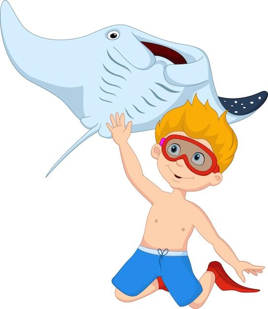 Cartoon kleine jongen duiken met stingray Premium Vector