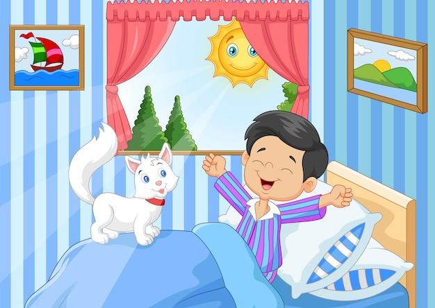 Cartoon kleine jongen wakker en geeuwen Premium Vector