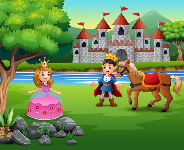 Cartoon prins en prinses met een kasteel achtergrond Premium Vector