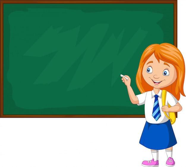 Cartoon schoolmeisje in uniform schrijven op het bord Premium Vector