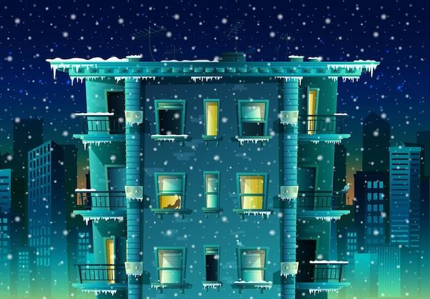 Cartoon stijl nacht winter stad met sneeuwvlokken achtergrond gebouw met veel vloeren en ramen met balkons Gratis Vector