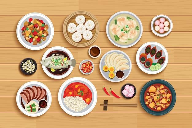 Chinees eten op bovenaanzicht houten achtergrond. Premium Vector