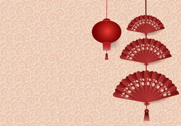 Chinese lantaarn vouwende ventilator die op patroon hangen Premium Vector