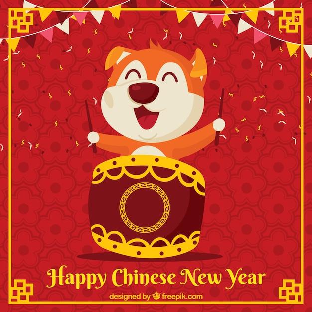 Chinese nieuwe jaarachtergrond met speelse hond Gratis Vector