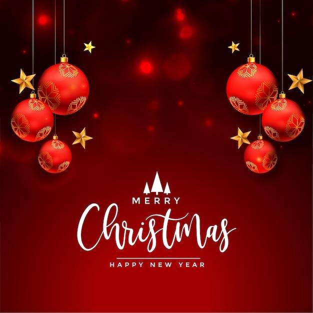 Christmas wenskaart wenst met realistische rode ballen Gratis Vector