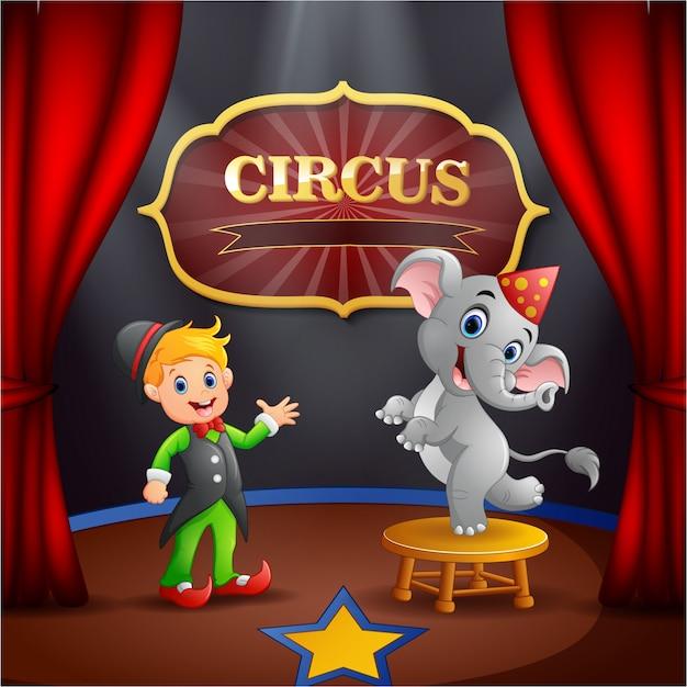 Circustrainer met olifant op het podium Premium Vector