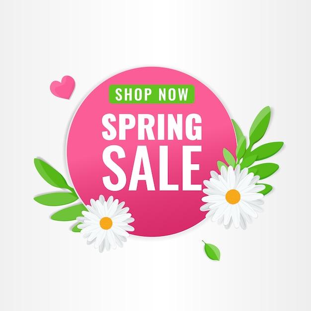 Cirkel roze banner voor de lenteverkoop met kamillebloemen en groene bladeren Premium Vector