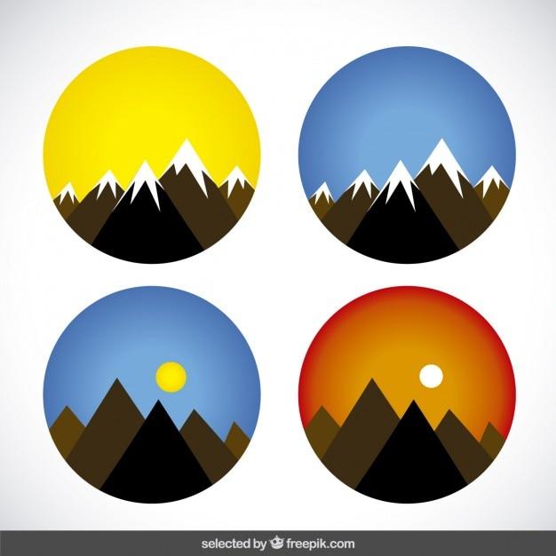 Cirkels met bergen Gratis Vector