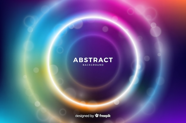 Cirkels met kleurrijk licht omringd door kleinere cirkels Gratis Vector
