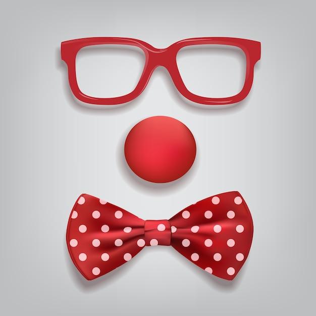 Clownaccessoires geïsoleerd op grijze achtergrond, clownglazen, neus en vlinderdas polka dot. Premium Vector