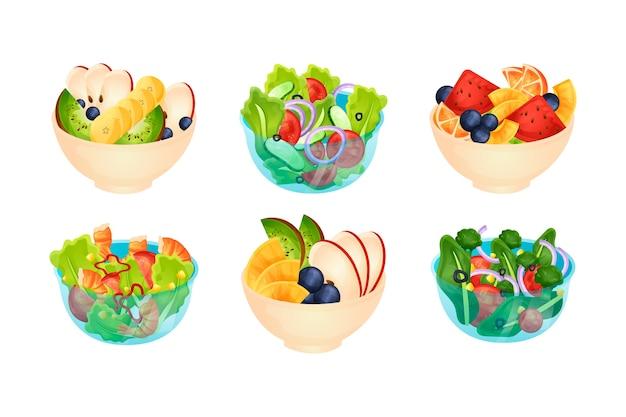 Collectie van fruit en salade kommen Gratis Vector