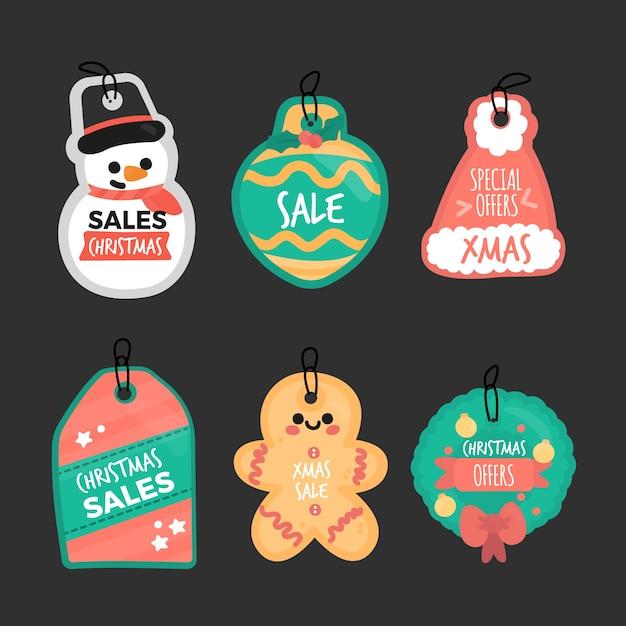 Collectie van hand getrokken kerst verkoop tag Gratis Vector