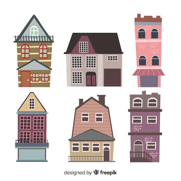 Collectie van platte vintage huizen Gratis Vector