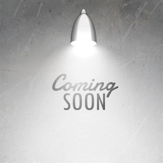 Tekst Op Muur.Coming Soon Onder Gloeiende Lamp Geplaatste Tekst Op Grijze Geweven