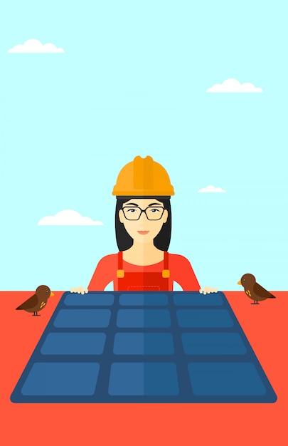 Constructor met zonnepaneel. Premium Vector