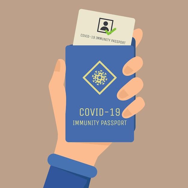 Covid-19 immuniteitspaspoort plat. hand met paspoort Premium Vector