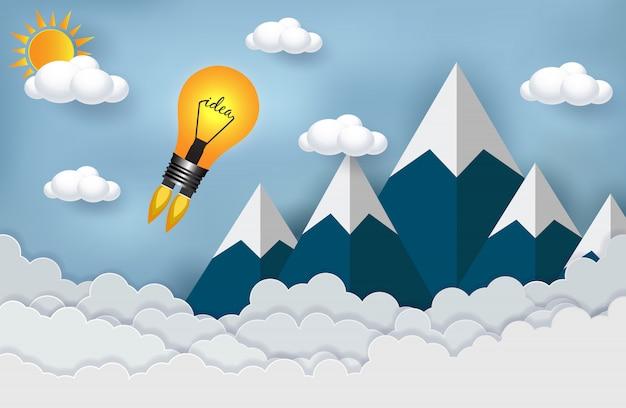 Creatief idee. lamp lancering in de tussen hemel en berg Premium Vector