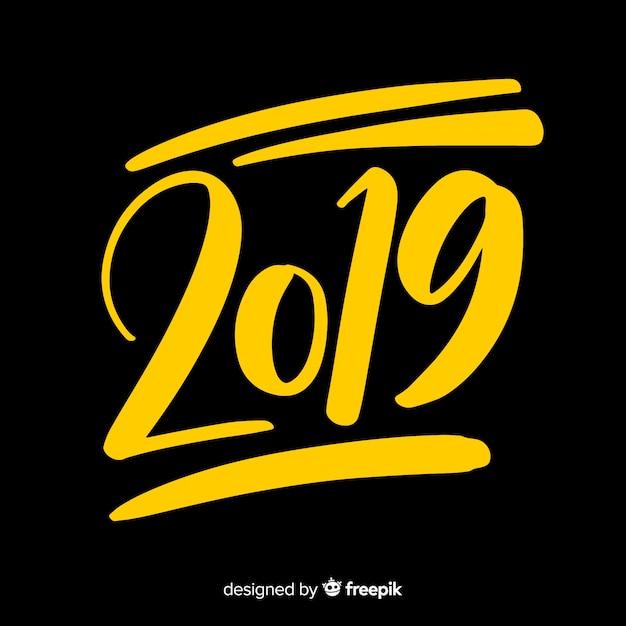 Creatieve 2019 belettering achtergrond Gratis Vector