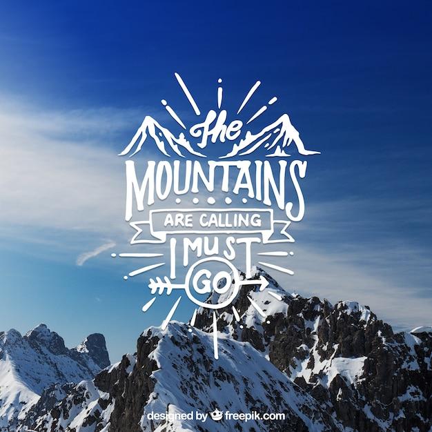 Creatieve belettering en citaat ontwerp op berg achtergrond Gratis Vector