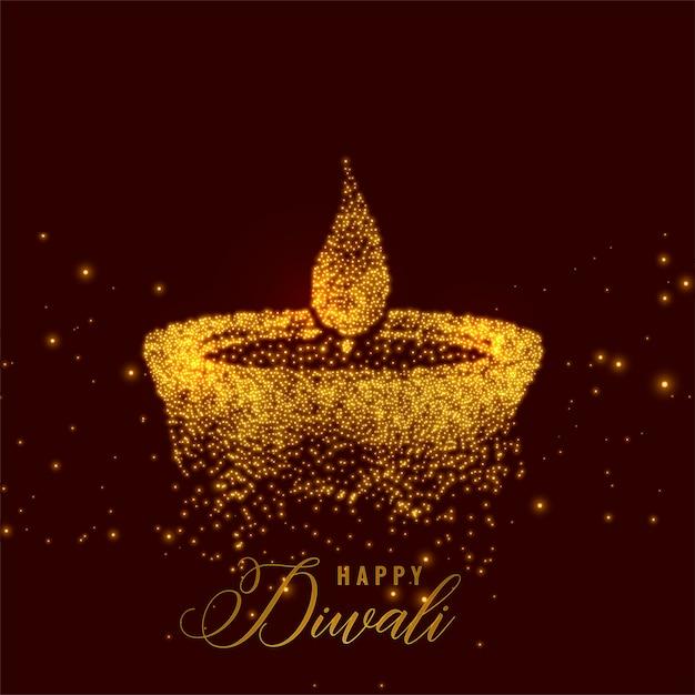 Creatieve diwali diya gemaakt met gouden deeltjes Gratis Vector