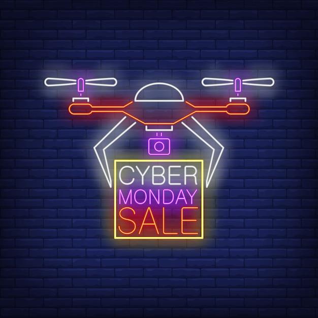 Cybermaandag verkoop neon-tekst in frame wordt gedragen door drone Gratis Vector