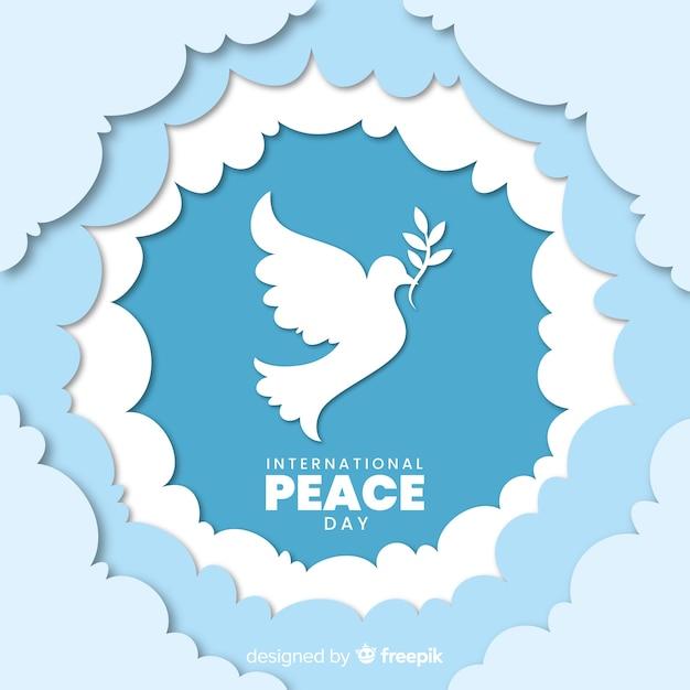 Dag van de vrede met duif op papier Gratis Vector