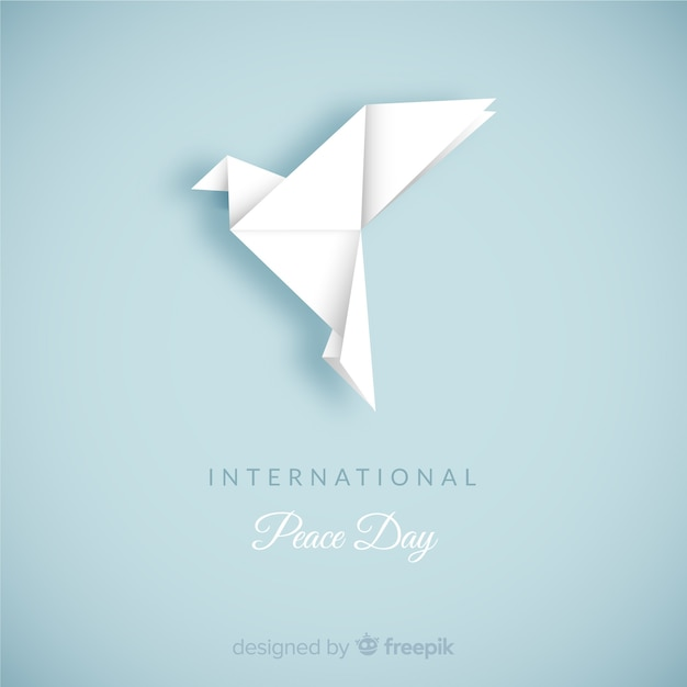 Dag van vredessamenstelling met origami witte duif Gratis Vector