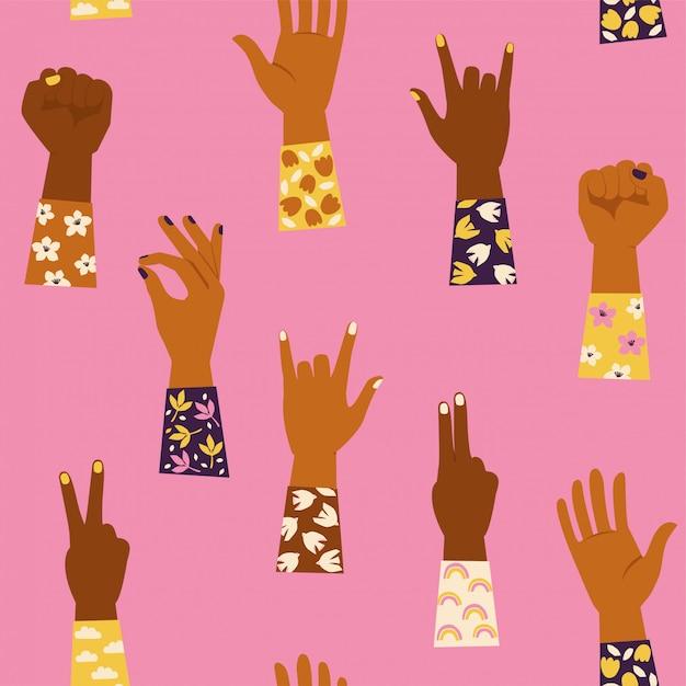 Dames handen met haar vuist omhoog en met verschillende handengebaren. girl power. feminisme. naadloze patroon Premium Vector