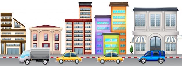 De achtergrond van de stadsscène met gebouwen en auto's op weg Gratis Vector