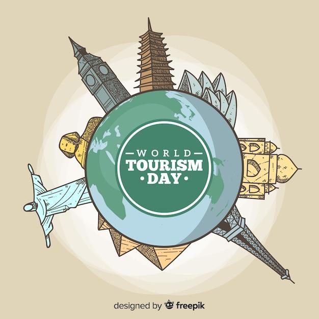 De achtergrond van de toerismedag met wereld en monumenten ter beschikking getrokken stijl Gratis Vector