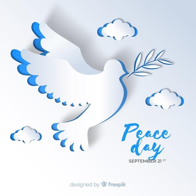 De achtergrond van de vredesdag met duif Gratis Vector