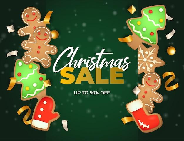 De banner van de kerstmisverkoop met gemberbrood op groene grond Gratis Vector