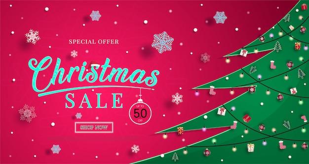 De banner van de kerstmisverkoop met sneeuwvlokken en om te winkelen de illustratie of de achtergrond van de kortingsbevordering Premium Vector