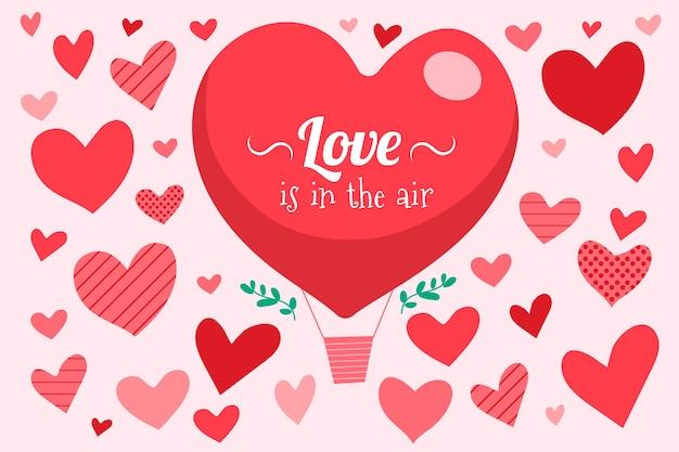 De dagachtergrond van de gelukkige valentijnskaart met het hart van de hete luchtballon Gratis Vector