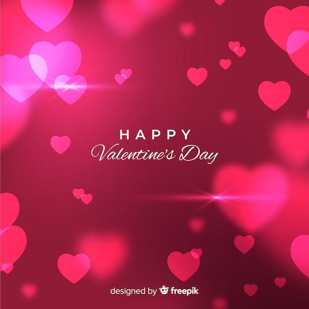 De dagachtergrond van vage glanzende harten valentijnsdag Gratis Vector