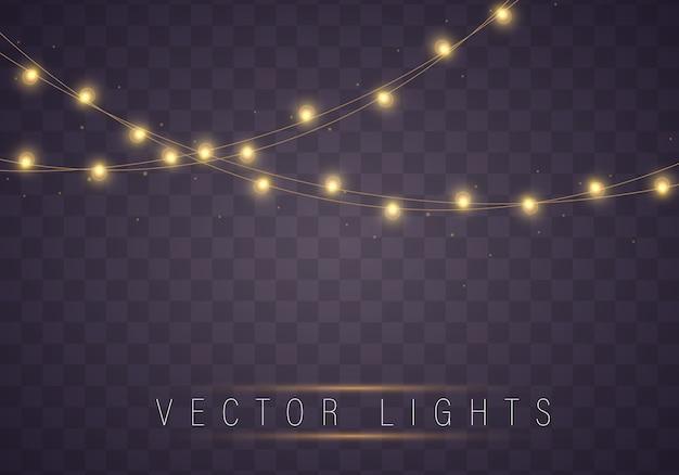 De gele kerstmislichten isoleerden realistische elementen. Premium Vector