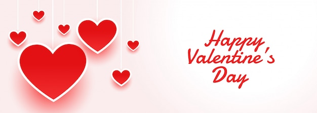 De gelukkige aantrekkelijke banner van de valentijnskaartendag met harten Gratis Vector