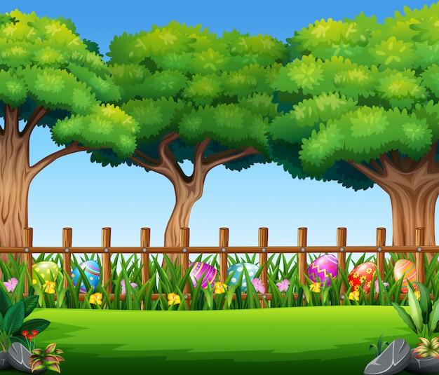 De gelukkige achtergrond van de paaseiaard met grote boom Premium Vector