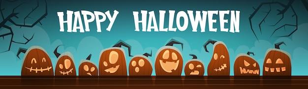 De gelukkige halloween-traditionele decoratie van banner verschillende pompoenen Premium Vector