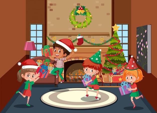 De gelukkige kinderen vieren kerstmis Premium Vector