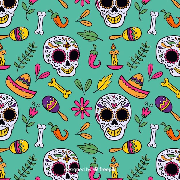 De gelukkige schedel en de mexicaanse elementen overhandigen getrokken día de muertos patroon Gratis Vector