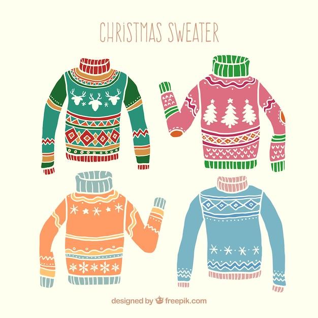 De hand getekend gekleurde kerst truien Gratis Vector