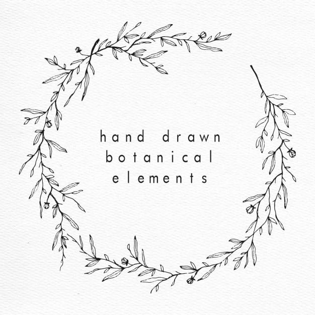 De hand getekende bloemen en botanische krans Gratis Vector