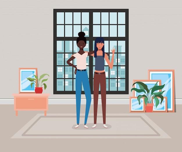 De jonge meisjes tussen verschillende rassen koppelen in het huis Premium Vector