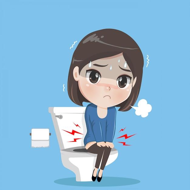 De jonge vrouw zit in het toilet. Premium Vector