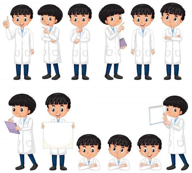 De jongen in wetenschapstoga in verschillend stelt op wit Gratis Vector