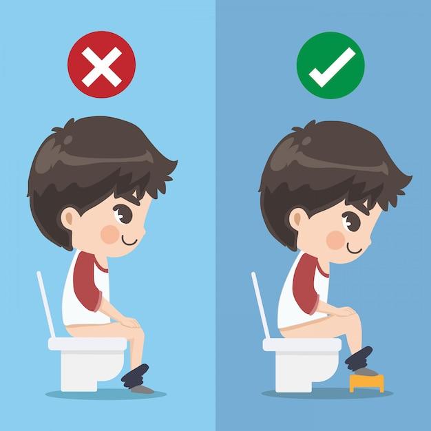 De jongen laat zien hoe je correct in de wc-bril moet zitten. Premium Vector